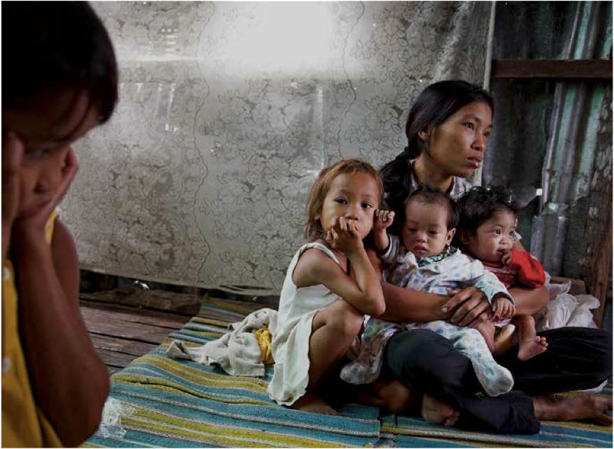 AT RISK. A family in the aftermath of Typhoon Yolanda. Photo from Save The Children's 2014 State of the World's Mothers Report