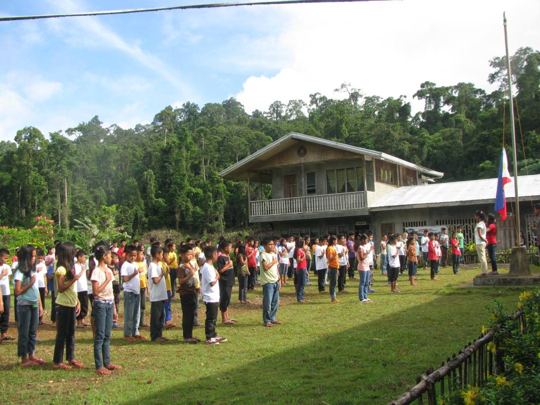 ALCADEV lumad students at a flag-raising ceremony. Photo courtesy of ALCADEV, Inc.