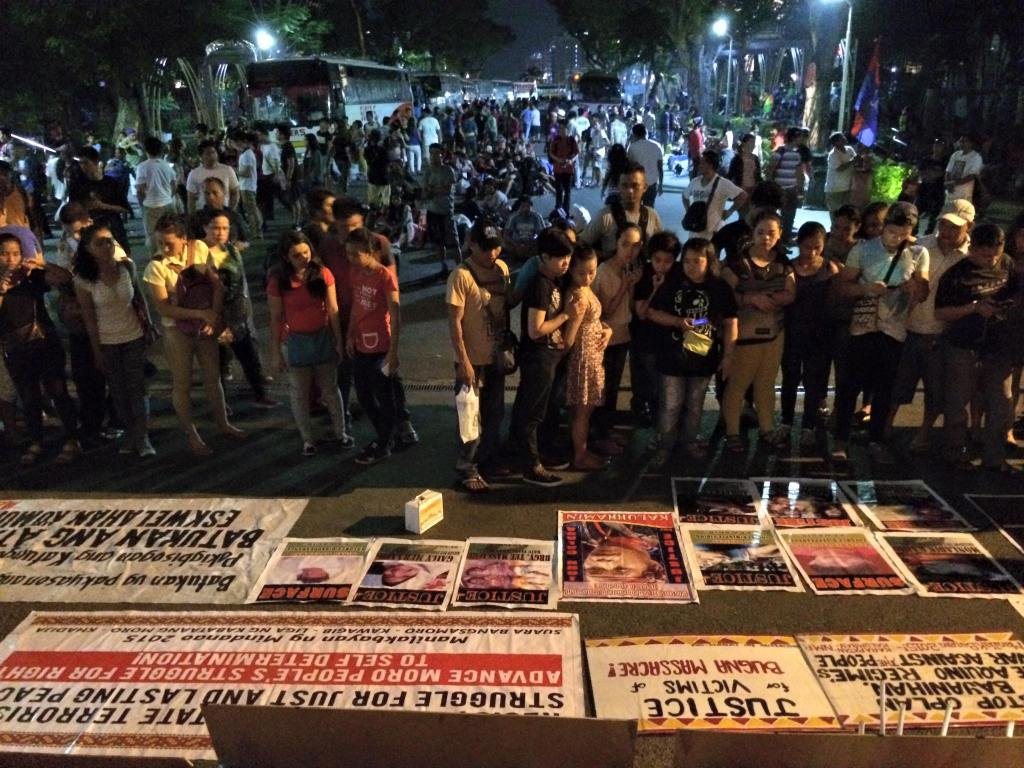 Parishoners at the Redemptorist Church in Baclaran view posters of Lumad killed under President Benigno Aquino III's administration,