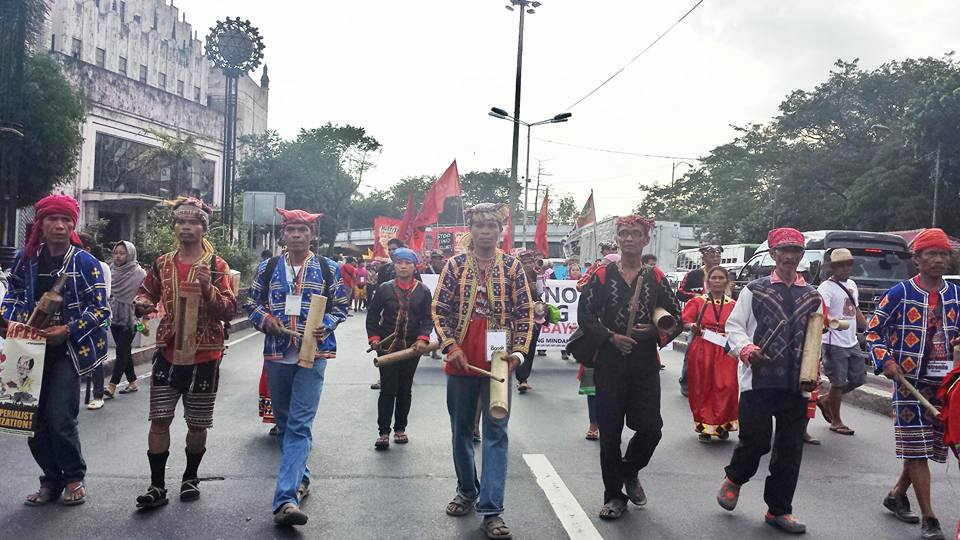"Manilakbayan 2015 contingents march towards Mendiola banging their ""bangkakawan"" to protest their early eviction from Liwasang Bonifacio (Photo by Kilab Muiltimedia)"