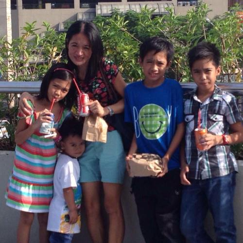 Ednalyn with her children (in stripes and blue shirt) and their cousins). Photo courtesy of Ednalyn