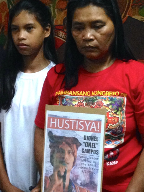 Eufemia Cullamat (right) and her niece, Sheina, who witnessed the execution of her father, Dionel Campos, by paramilitary forces on Sept. 1 in Han-ayan, Lianga, Surigao del Sur.