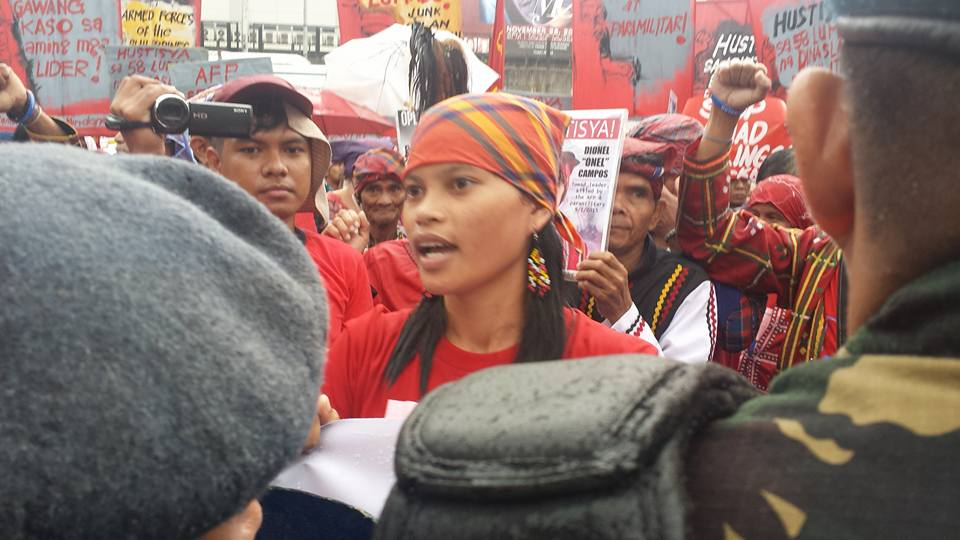 Dionel Campos', daughter, Michelle graduated from Alcadev, passed the equivalency exams and was enrolled in a BS Education course when militia murdered her father. She has dropped out to seek justice for his death. Here, she leads protests at Camp Aguinaldo. (Photo by Kilam Multimedia)